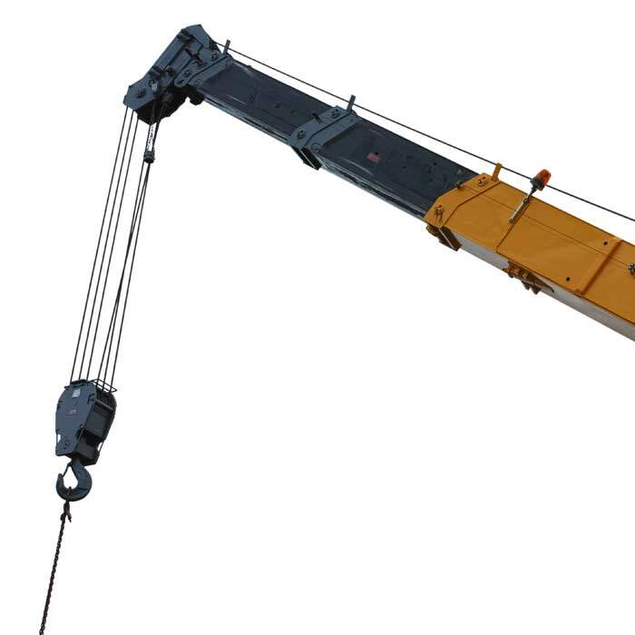 Crane boom - yellow and black with hanging pulley against white backdrop